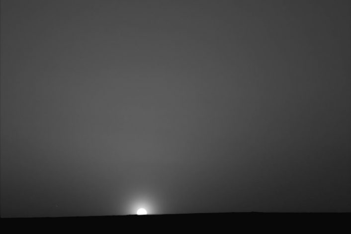 This red-filter image taken by the lander's Surface Stereo Imager, shows the sun rising on the morning of sol 90, August 25, 2008, the last day of the Phoenix Mars Lander nominal mission. The image was taken at 51 minutes past midnight local solar time during the slow sunrise that followed a 75 minute night. The skylight in the image is light scattered off atmospheric dust particles and ice crystals.